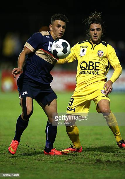 Brandon Lundy of the Jets contests the ball with Josh Risdon of the Glory during the FFA Cup match between Newcastle Jets and Perth Glory at Magic...