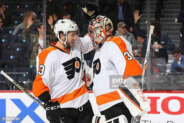 Brandon Manning and Steve Mason of the Philadelphia Flyers celebrate their win over the New York Islanders at the Barclays Center on March 21 2016 in...