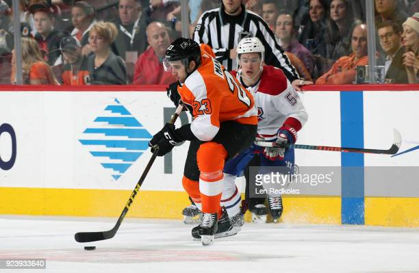 Brandon Manning of the Philadelphia Flyers skates the puck against Charles Hudon of the Montreal Canadiens on February 20 2018 at the Wells Fargo...