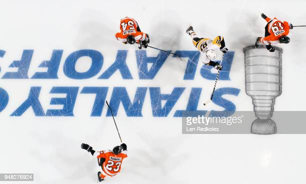 Brandon Manning Oskar Lindblom and Nolan Patrick of the Philadelphia Flyers skate across the Stanley Cup Playoffs logo on the ice against Phil Kessel...