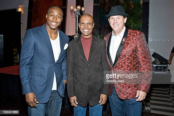 Brandon Marshall Gale Sayers and Neil Wilkinson attend the 10th Anniversary of Legends Fight Night at Chicago Illuminating Company on October 4 2012...