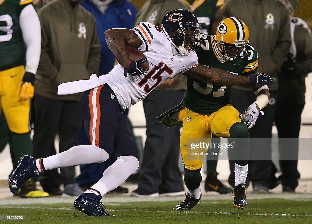 Brandon Marshall #15 of the Chicago Bears carries the football against Sam Shields #37 of the Green Bay Packers in the first half of the game at Lambeau Field on November 9, 2014 in Green Bay, Wisconsin. Green Bay Packers defeat the Chicago Bears 55 to 14.