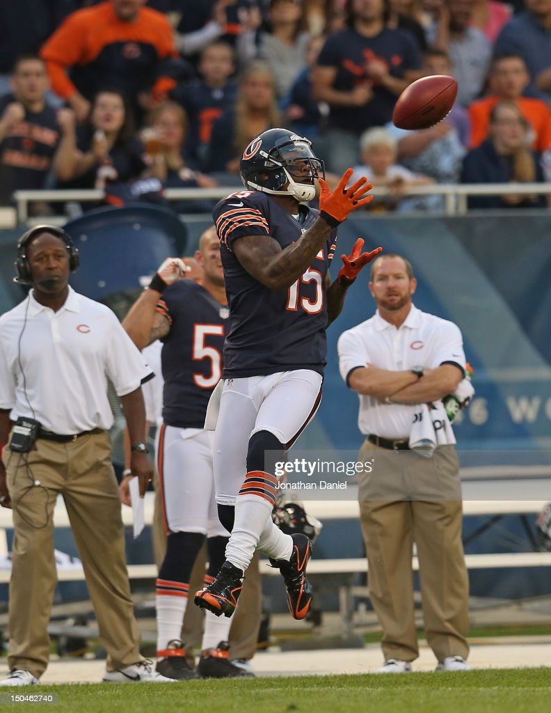 Brandon Marshall #15 of the Chicago Bears catches a long pass against the Washington Redskins during a preseason game at Soldier Field on August 18, 2012 in Chicago, Illinois.