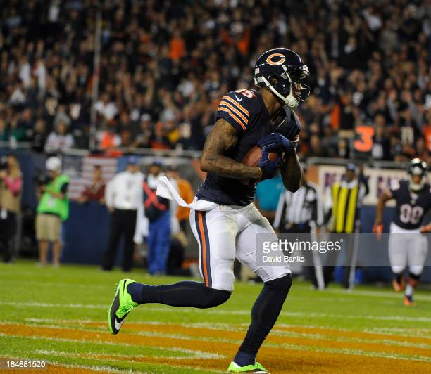 Brandon Marshall of the Chicago Bears catches a touchdown pass against the New York Giants on October 10 2013 at Soldier Field in Chicago Illinois