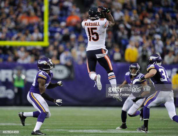 Brandon Marshall of the Chicago Bears catches the ball as Xavier Rhodes Robert Blanton and Andrew Sendejo of the Minnesota Vikings looks on during...