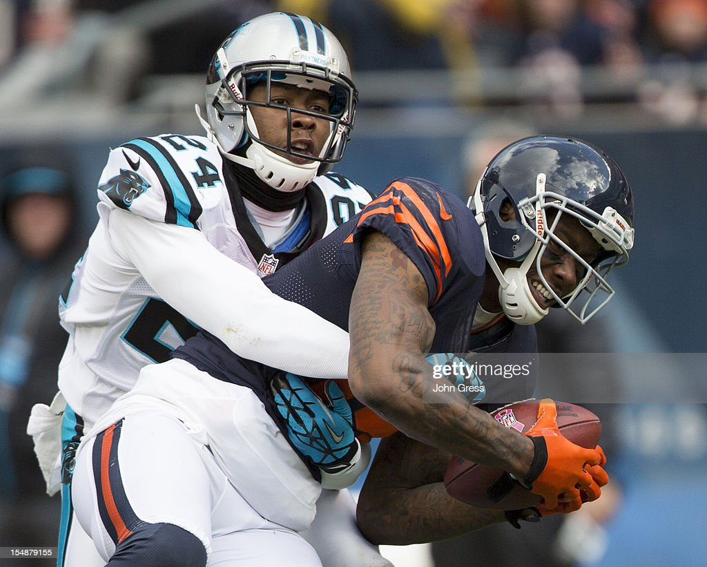 Brandon Marshall #15 of the Chicago Bears catches the ball while being covered by Josh Norman #24 of the Carolina Panthers on October 28, 2012 at Soldier Field in Chicago, Illinois.