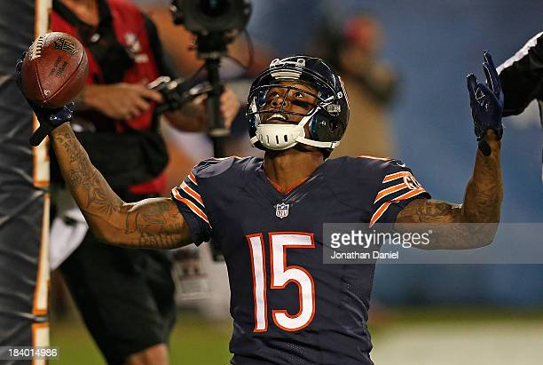 Brandon Marshall of the Chicago Bears celebrates a touchdown catch against the New York Giants at Soldier Field on October 10 2013 in Chicago...