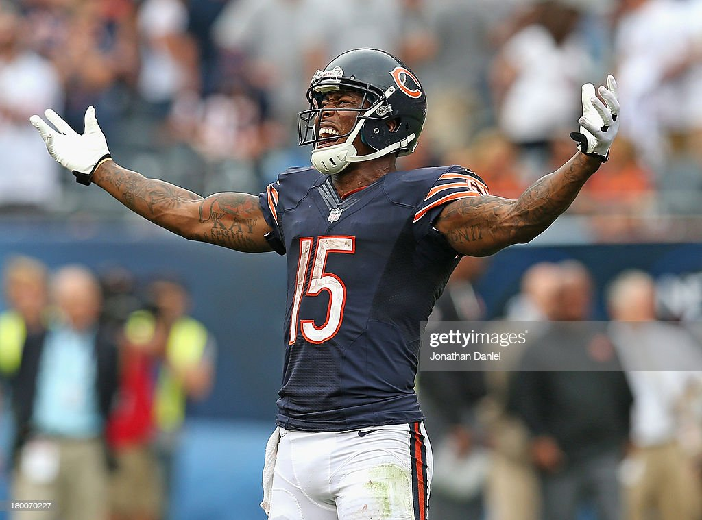 Brandon Marshall #15 of the Chicago Bears celebrates a win over the Cincinnati Bengals in the final seconds at Soldier Field on September 8, 2013 in Chicago, Illinois. The Bears defeated the Bengals 24-21.