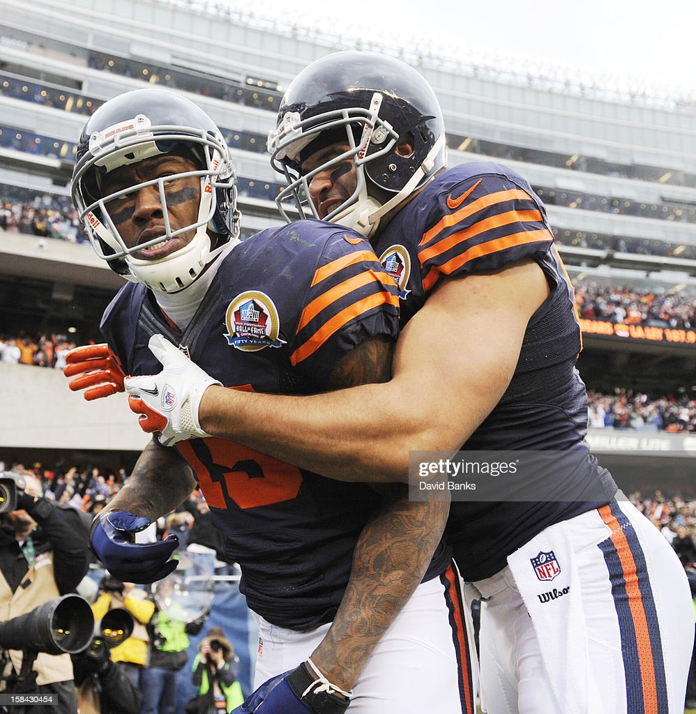 L-R Brandon Marshall #15 of the Chicago Bears is greeted by Kellen Davis #87 after scoring a touchdown against the Green Bay Packers on December 16, 2012 at Soldier Field in Chicago, Illinois.