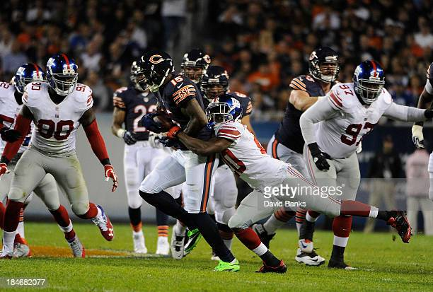 Brandon Marshall of the Chicago Bears is tackled by Prince Amukamara of the New York Giants on October 10 2013 at Soldier Field in Chicago Illinois