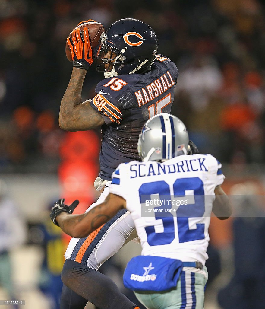 Brandon Marshall #15 of the Chicago Bears makes a first down catch over Orlando Scandrick #32 of the Dallas Cowboys at Soldier Field on December 9, 2013 in Chicago, Illinois.