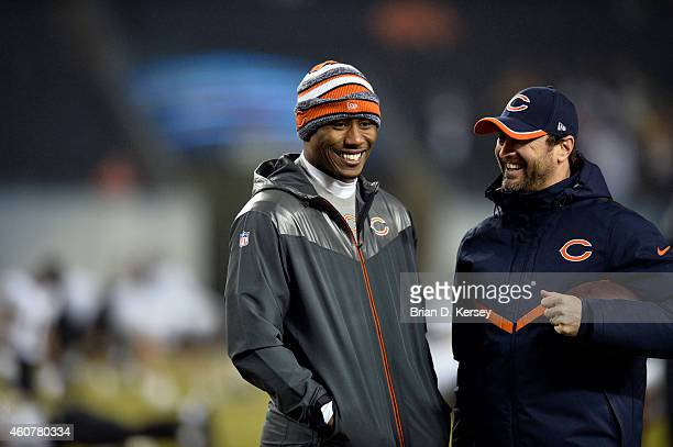 Brandon Marshall of the Chicago Bears talks with wide receiver coach Mike Groh before the game against the New Orleans Saints at Soldier Field on...