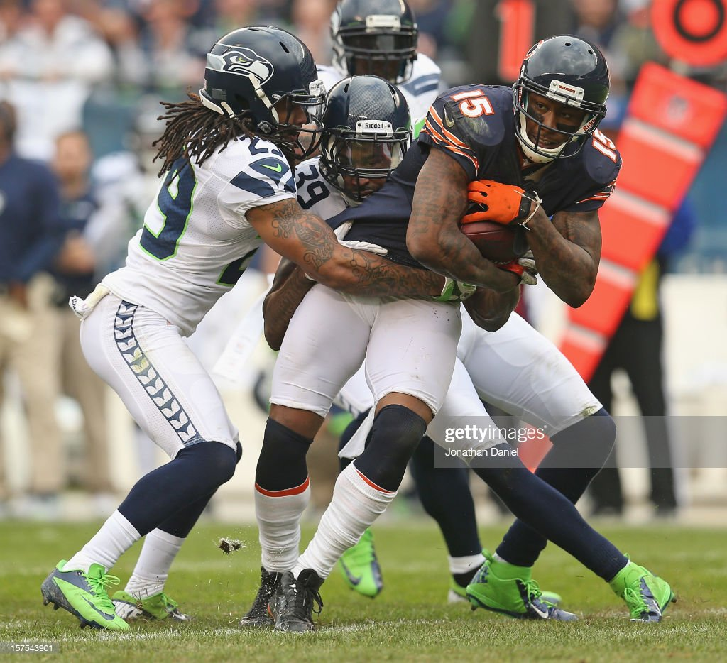 Brandon Marshall #15 of the Chicago Bears tries to break away from Earl Thomas #29 and Brandon Browner #39 of the Seattle Seahawks at Soldier Field on December 2, 2012 in Chicago, Illinois. The Seahawks defeated the Bears 23-17 in overtime.