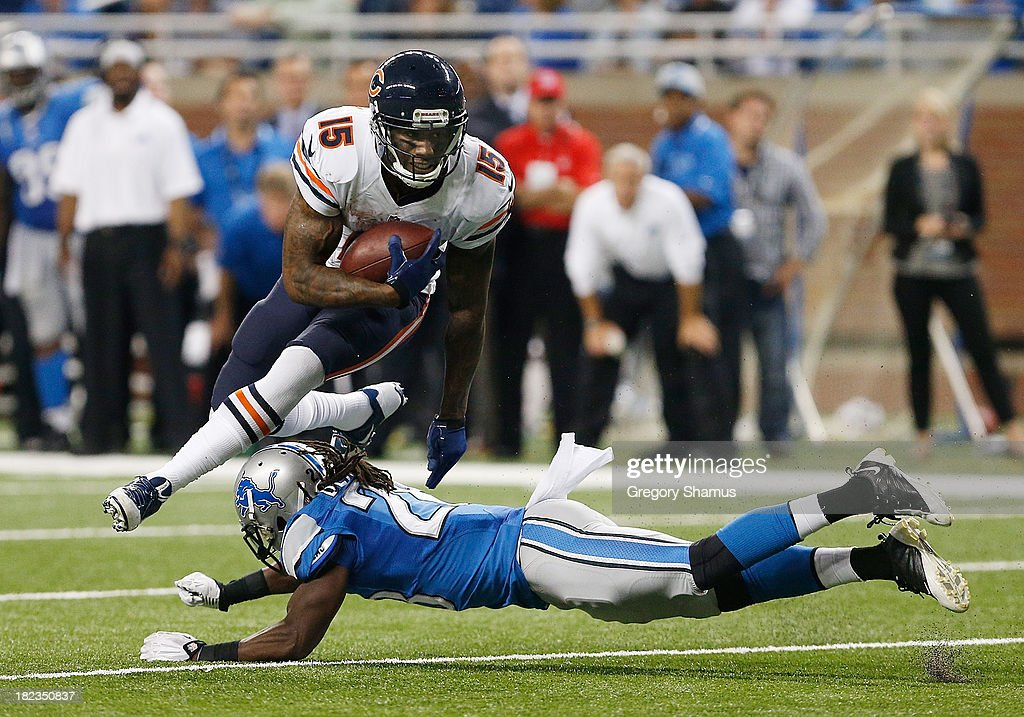 Brandon Marshall #15 of the Chicago Bears tries to gain extra yards after a fourth quarter catch over Louis Delmas #26 of the Detroit Lions at Ford Field on September 29, 2013 in Detroit, Michigan. Detroit won the game 40-32.