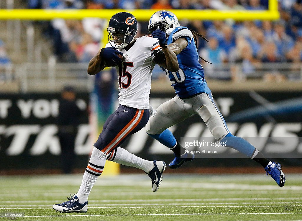 Brandon Marshall #15 of the Chicago Bears tries to outrun Louis Delmas #26 of the Detroit Lions after a fourth quarter catch at Ford Field on September 29, 2013 in Detroit, Michigan. Detroit won the game 40-32.