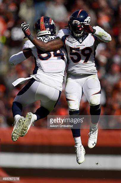 Brandon Marshall of the Denver Broncos celebrates his sack on Josh McCown of the Cleveland Browns with teammate Danny Trevathan during the first half...