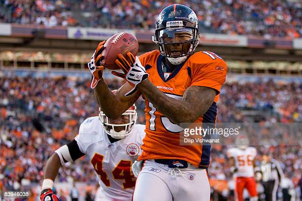 Brandon Marshall of the Denver Broncos hauls in a touchdown pass against Jarred Page of the Kansas City Chiefs at Invesco Field at Mile High on...