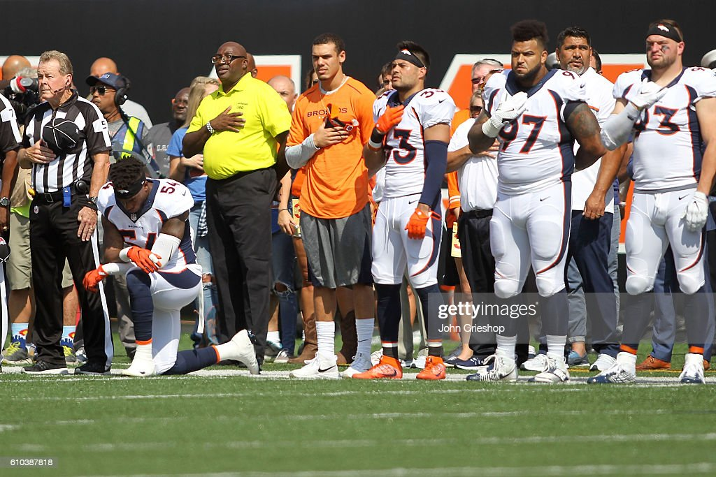 best service cbcd7 e98b3 Brandon Marshall of the Denver Broncos kneels down during ...