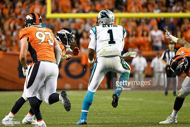 Brandon Marshall of the Denver Broncos lines up Cam Newton of the Carolina Panthers after he dumps pass to Jonathan Stewart during the third quarter...