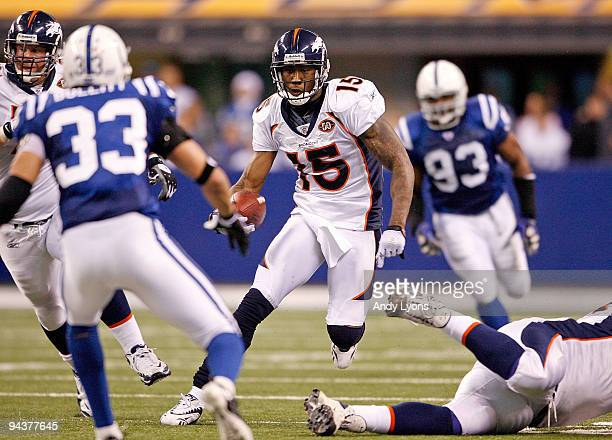 Brandon Marshall of the Denver Broncos runs with the ball during the NFL game against the Indianapolis Colts at Lucas Oil Stadium on December 13 2009...
