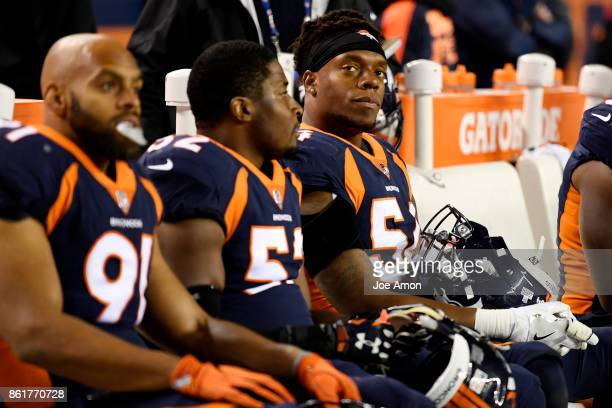 Brandon Marshall of the Denver Broncos sits on the bench as the Broncos struggle to get going against the New York Giants during the second quarter...