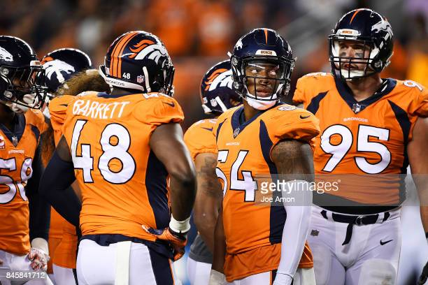 Brandon Marshall of the Denver Broncos takes a breather with Shaquil Barrett and Derek Wolfe during the second quarter on Monday September 11 2017...