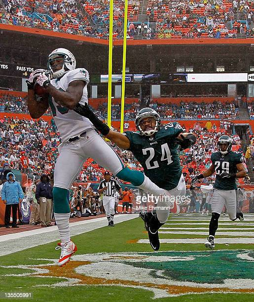 Brandon Marshall of the Miami Dolphins catches a touchdown pass against Nnamdi Asomugha of the Philadelphia Eagles during a game at Sun Life Stadium...