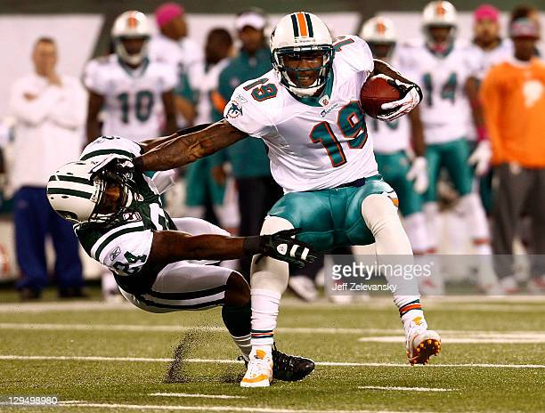 Brandon Marshall of the Miami Dolphins hits Darrelle Revis of the New York Jets during their game at MetLife Stadium on October 17, 2011 in East...