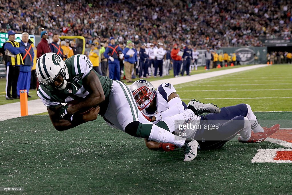 Brandon Marshall #15 of the New York Jets catches a one yard touchdown pass against Malcolm Butler #21 of the New England Patriots during the second quarter in the game at MetLife Stadium on November 27, 2016 in East Rutherford, New Jersey.