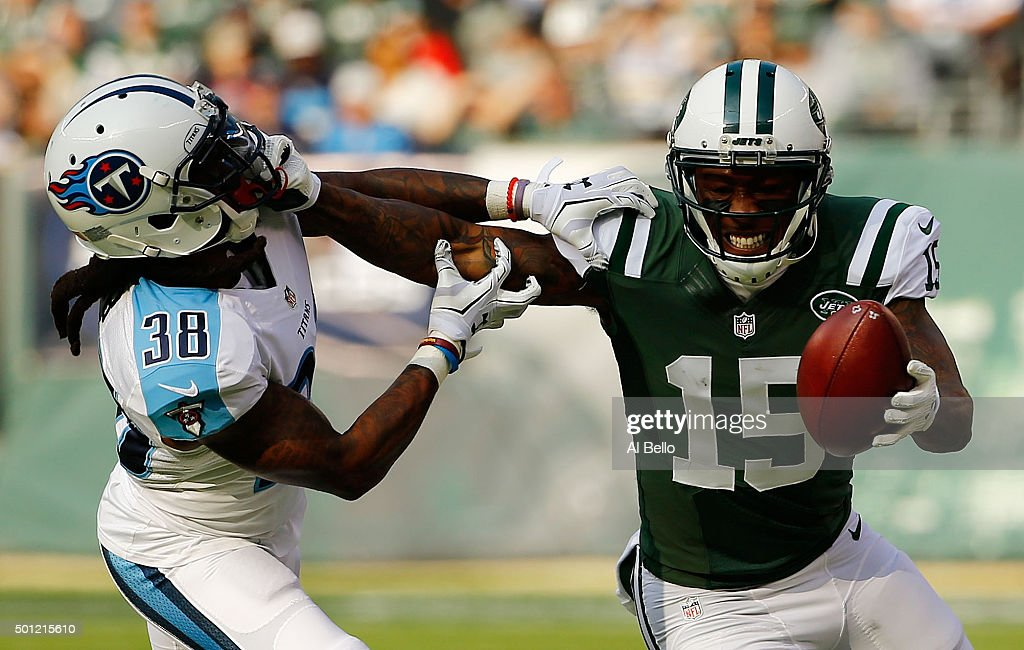 Brandon Marshall #15 of the New York Jets grabs the face mask of B.W. Webb #38 of the Tennessee Titans as he tries to avoid his tackle in the first quarter during their game at MetLife Stadium on December 13, 2015 in East Rutherford, New Jersey.