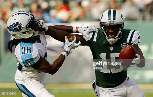 Brandon Marshall of the New York Jets grabs the face mask of BW Webb of the Tennessee Titans as he tries to avoid his tackle in the first quarter...