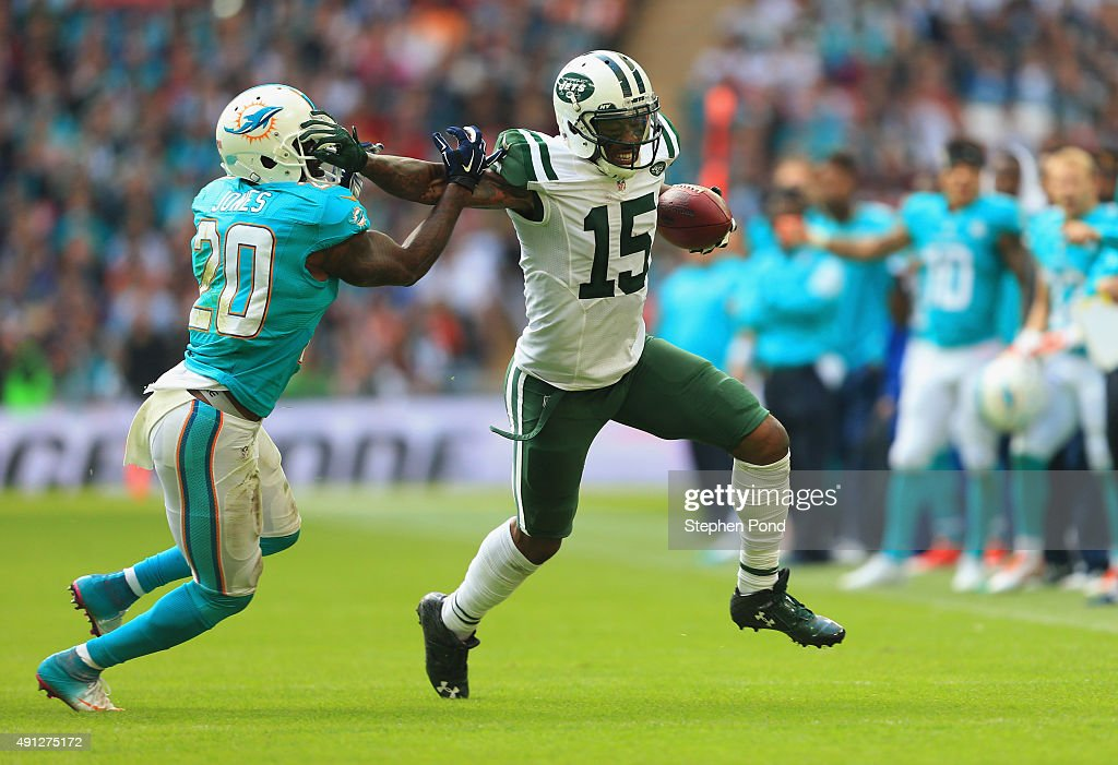 Brandon Marshall #15 of the New York Jets holds off Reshad Jones #20 of the Miami Dolphins during the game at Wembley Stadium on October 4, 2015 in London, England.