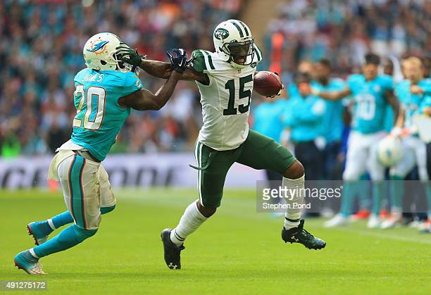 Brandon Marshall of the New York Jets holds off Reshad Jones of the Miami Dolphins during the game at Wembley Stadium on October 4 2015 in London...