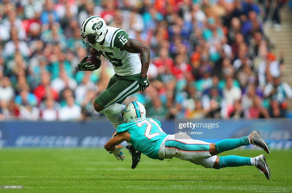 Brandon Marshall #15 of the New York Jets is tackled by Brent Grimes #21 of the Miami Dolphins during the game at Wembley Stadium on October 4, 2015 in London, England.