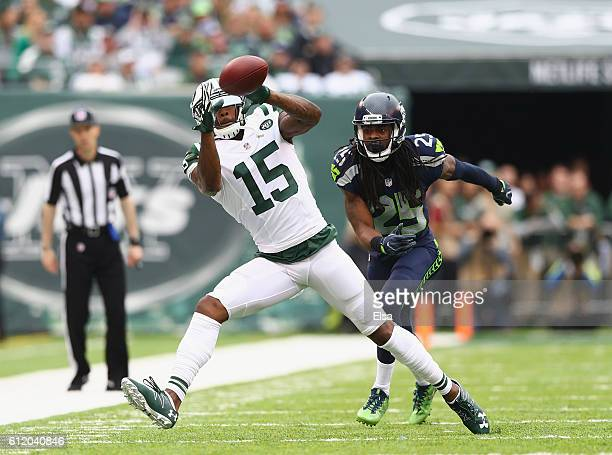 Brandon Marshall of the New York Jets makes a catch against Richard Sherman of the Seattle Seahawks in the first half at MetLife Stadium on October 2...