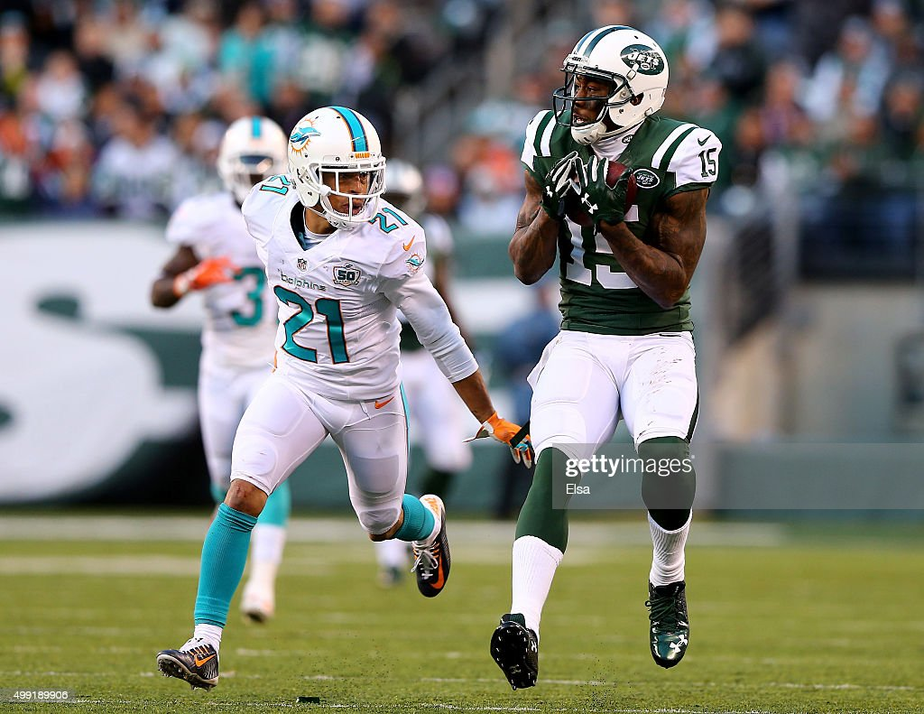 Brandon Marshall #15 of the New York Jets makes the catch as Brent Grimes #21 of the Miami Dolphins defends on November 29, 2015 at MetLife Stadium in East Rutherford, New Jersey.