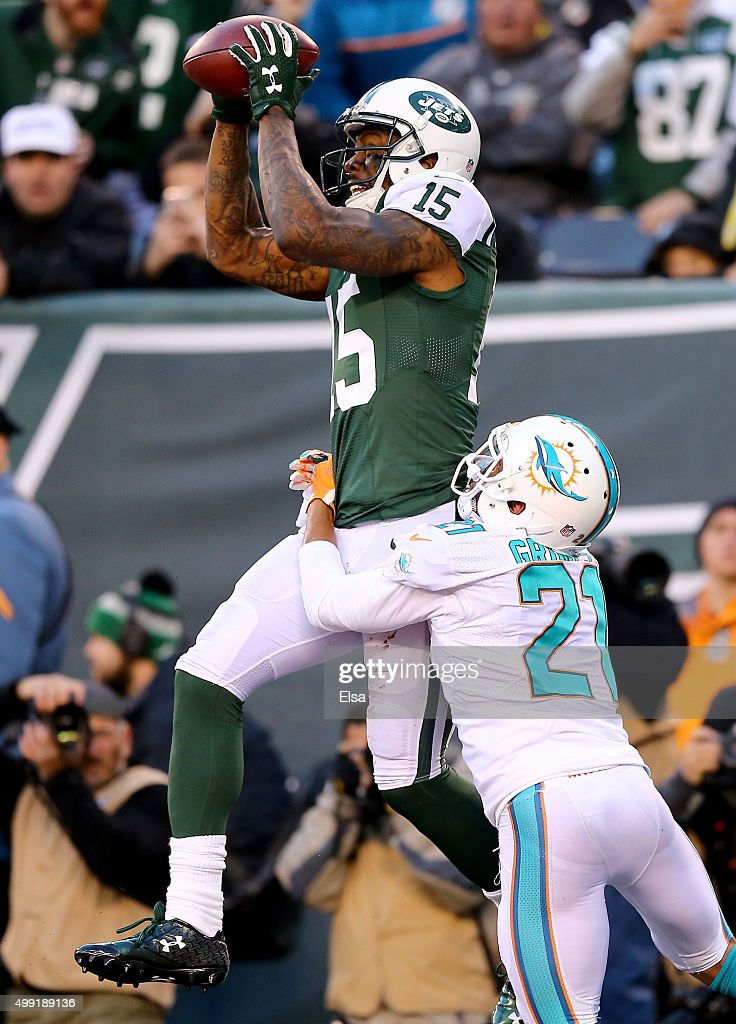 Brandon Marshall #15 of the New York Jets makes the touchdown catch as Brent Grimes #21 of the Miami Dolphins defends in the fourth quarter on November 29, 2015 at MetLife Stadium in East Rutherford, New Jersey.