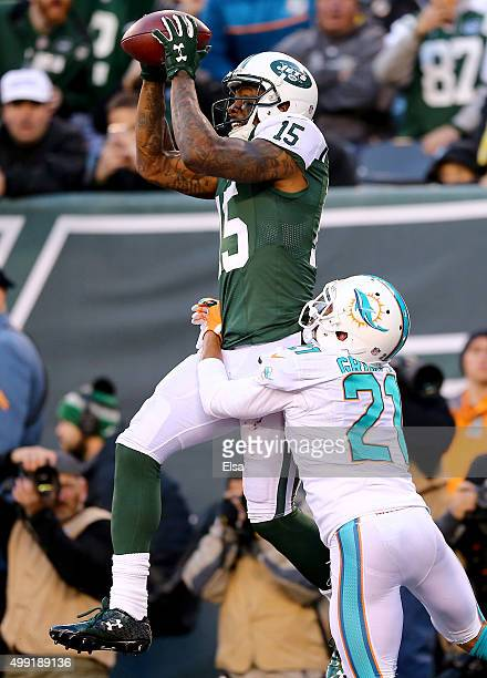 Brandon Marshall of the New York Jets makes the touchdown catch as Brent Grimes of the Miami Dolphins defends in the fourth quarter on November 29...