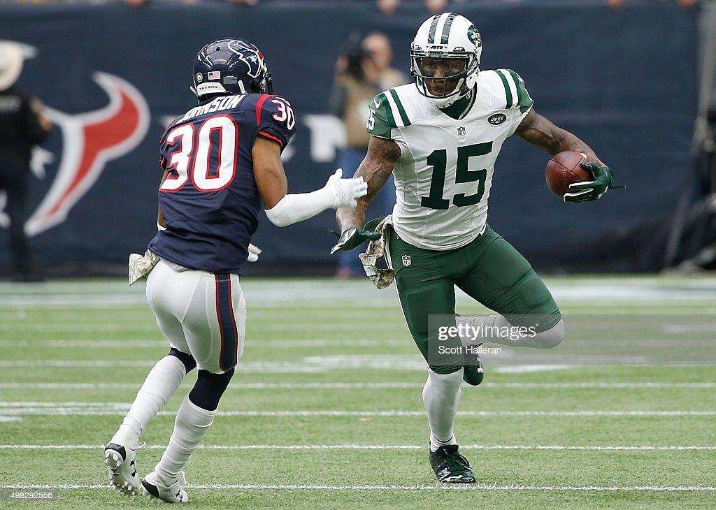 Brandon Marshall #15 of the New York Jets runs against Kevin Johnson #30 of the Houston Texans on November 22, 2015 at NRG Stadium in Houston, Texas.