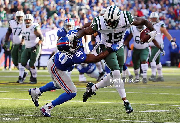 Brandon Marshall of the New York Jets runs with the ball against Prince Amukamara of the New York Giants at MetLife Stadium on December 6 2015 in...