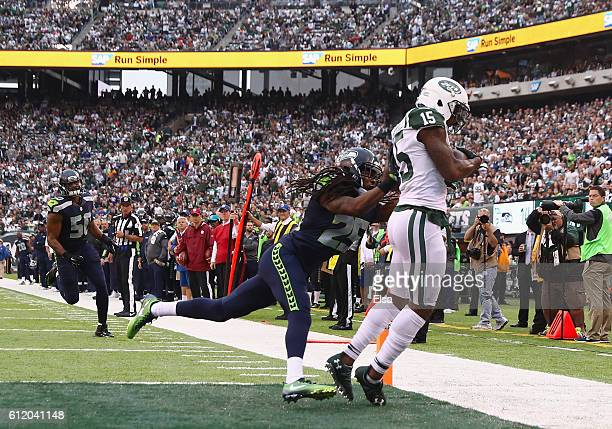 Brandon Marshall of the New York Jets score a second quarter touchdown against Richard Sherman of the Seattle Seahawks at MetLife Stadium on October...