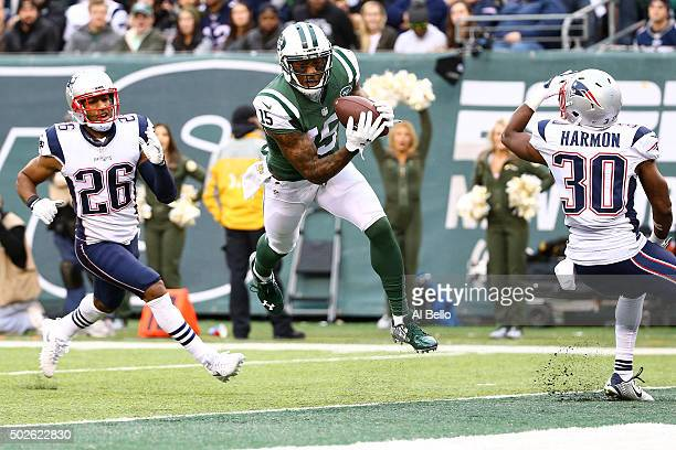 Brandon Marshall of the New York Jets scores a 33 yard touchdown in the third quarter against the New England Patriots during their game at MetLife...