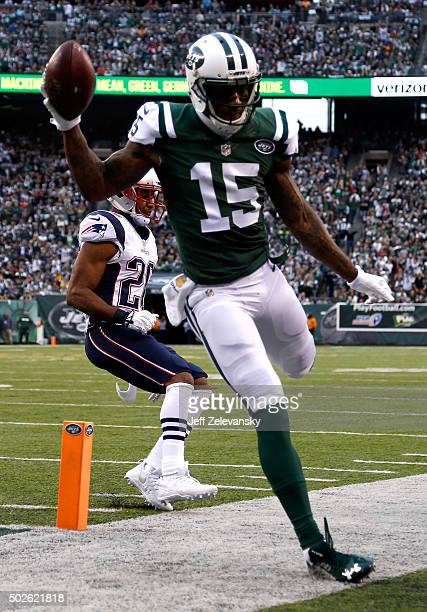 Brandon Marshall of the New York Jets scores a touchdown in the second quarter against the New England Patriots during their game at MetLife Stadium...