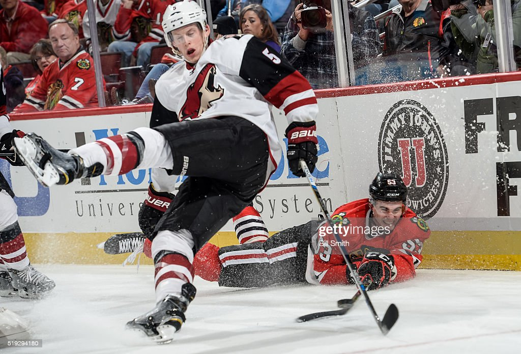 Brandon Mashinter #53 of the Chicago Blackhawks and Connor Murphy #5 of the Arizona Coyotes collide while chasing the puck in the third period of the NHL game at the United Center on April 5, 2016 in Chicago, Illinois.