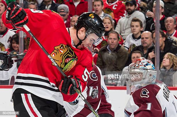 Brandon Mashinter of the Chicago Blackhawks hits the puck to score on goalie Semyon Varlamov of the Colorado Avalanche in the first period of the NHL...