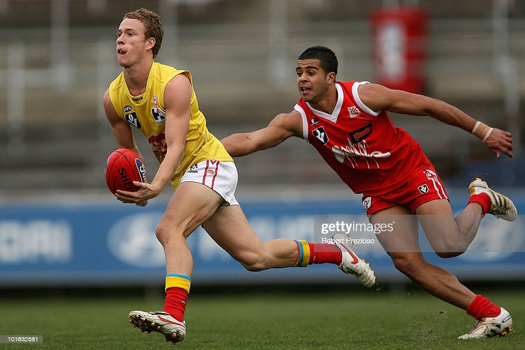 Brandon Matera of the Gold Coast handballs under pressure during the round eight VFL match between the Bullants and the Gold Coast on June 5, 2010 in Melbourne, Australia.