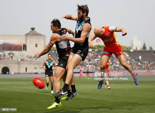 Brandon Matera of the Suns and Ollie Wines of the Power compete for the ball during the 2017 AFL round 08 match between the Gold Coast Suns and Port...