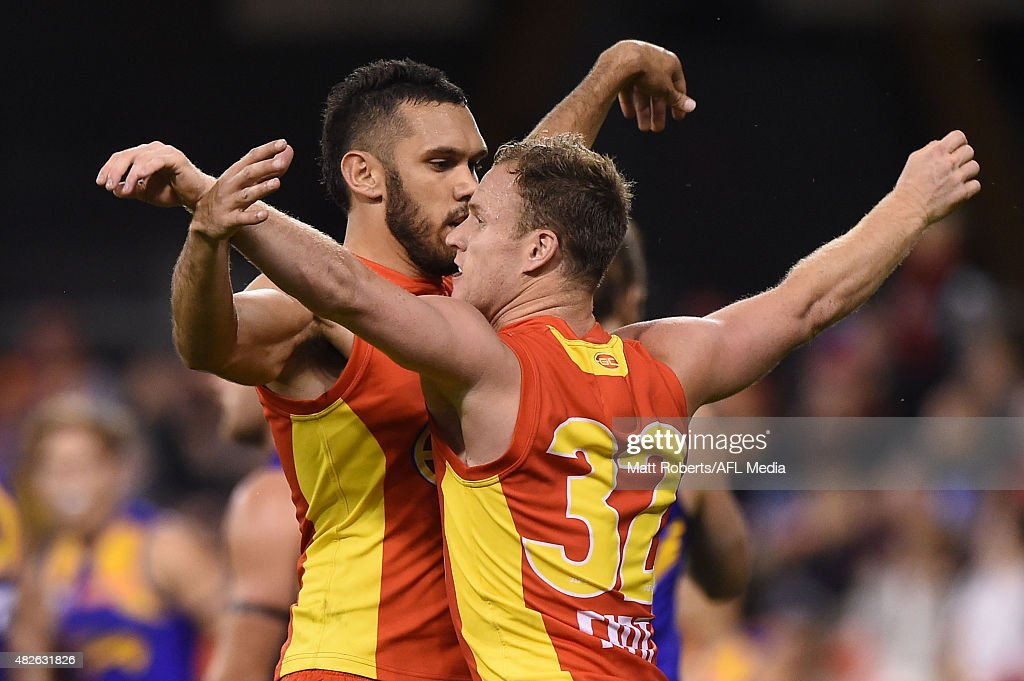 Brandon Matera of the Suns celebrates kicking a goal with Harley Bennell during the round 18 AFL match between the Gold Coast Suns and the West Coast Eagles at Metricon Stadium on August 1, 2015 in Gold Coast, Australia.