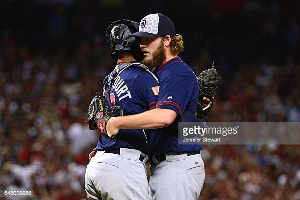 Brandon Maurer of the San Diego Padres is congratualted by Christian Bethancourt after closing out the game against the Arizona Diamondbacks at Chase...