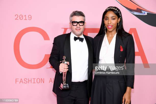Brandon Maxwell poses with the Womenswear Designer of the Year Award and Jessica Williams during Winners Walk during the CFDA Fashion Awards at the...